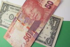 美元和南非兰特钞票 免版税库存图片