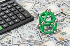 美元和房子有计算器的 免版税库存照片