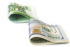 美元和欧元股票在白色 图库摄影