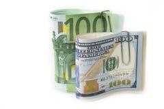 美元和欧元股票在白色 库存照片