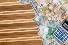 美元和欧洲钞票与硬币 免版税库存照片