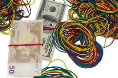 美元和欧洲笔记与橡皮筋 图库摄影