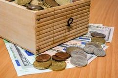 美元和欧洲金钱与硬币 免版税库存图片