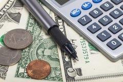 美元和计算器 免版税库存图片