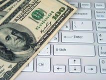 美元和计算机 免版税库存图片