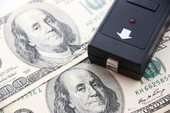 美元和金钱验查员 免版税库存照片