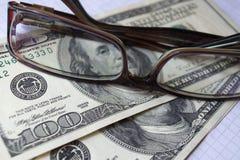 美元和玻璃 免版税图库摄影