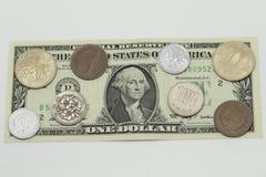 美元和JPN日元硬币 库存照片