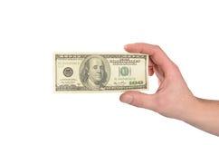 美元在白色隔绝的一个人的手上 免版税库存照片
