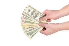 美元在白色隔绝的一个人的手上 图库摄影