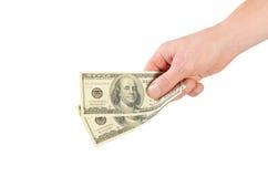 美元在白色隔绝的一个人的手上 库存照片