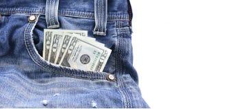 美元或金钱在蓝色牛仔布牛仔裤装在口袋里,概念在收入金钱,挽救金钱 免版税库存照片