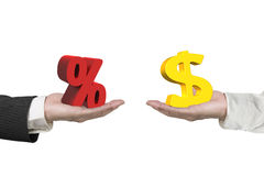 美元标志和百分率符号用两只手 免版税库存图片