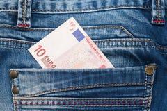 美元牛仔裤货币一矿穴二 免版税库存图片