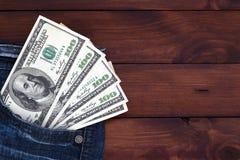 美元牛仔裤货币一矿穴二 免版税库存照片