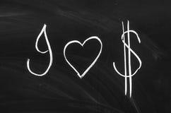 美元的符号和心脏形状 免版税库存照片
