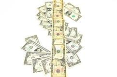 美元的符号由钞票驻扎在同一地点 免版税库存照片