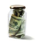 美元票据和硬币在玻璃瓶子 免版税库存照片