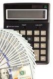 美元钞票和计算器 图库摄影
