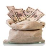 美元面额的50在白色隔绝的大袋 库存照片