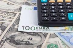 美元,欧洲背景计算器和钞票  库存照片
