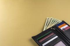 美元-另外衡量单位和精神钱包几张钞票  库存照片