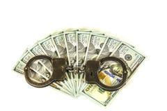 美国一百元钞票和手铐 图库摄影
