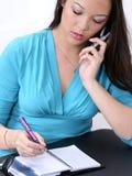 美国亚裔移动电话记事本妇女 免版税图库摄影
