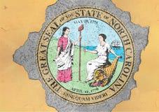 美国各州北卡罗来纳在具体孔绘的封印旗子 库存图片
