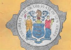 美国各州新泽西在大具体破裂的孔的旗子封印 库存照片