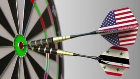 美国和叙利亚的旗子击中目标的舷窗的箭的 概念性的国际合作或的竞争 图库摄影