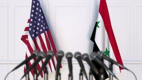 美国和叙利亚的旗子在国际会议或会议上 3d翻译 免版税库存图片