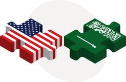美国和沙特阿拉伯旗子在难题 图库摄影