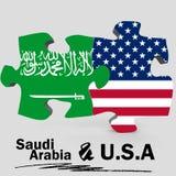 美国和沙特阿拉伯旗子在难题 免版税库存照片