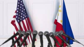 美国和菲律宾的旗子在国际会议或交涉新闻招待会 3D动画 股票录像