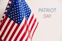 美国国旗和文本爱国者天 免版税库存照片