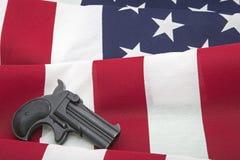 美国国旗大口径短筒手枪第二校正概念 免版税库存图片