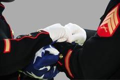 美国国旗折叠的战士 免版税库存图片