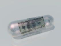美国在胶囊的100美元 免版税库存照片