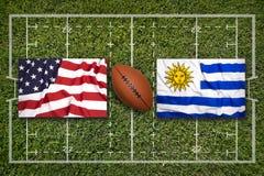 美国对 在橄榄球领域的乌拉圭旗子 库存照片