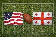 美国对 在橄榄球领域的乔治亚旗子 免版税库存图片