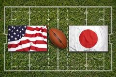 美国对 在橄榄球领域的日本旗子 图库摄影