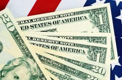 美国提供经费给并且收税概念与旗子 库存图片