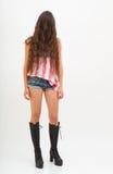 美国旗子、牛仔裤和黑起动的顶面颜色的妇女 免版税库存图片