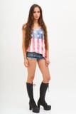 美国旗子、牛仔裤和黑起动的顶面颜色的妇女 库存照片