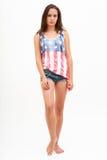 美国旗子和牛仔裤的顶面颜色的妇女 图库摄影