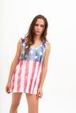 美国旗子和牛仔裤的顶面颜色的妇女 库存图片