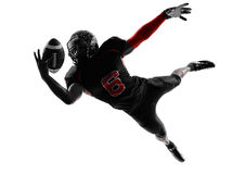 美国橄榄球运动员传染性的球剪影 库存照片