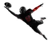 美国橄榄球运动员传染性的球剪影 库存图片