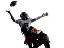 美国橄榄球运动员四分卫被袋装的摸索剪影 库存图片